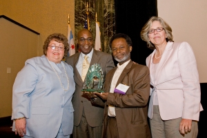 TASC President Melody Heaps, Board Chairman Rev. Calvin Morris, Public Voice Honoree Isaac Lewis, Jr., and Executive Vice President Pam Rodriguez
