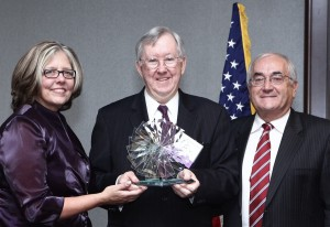 TASC President Pamela Rodriguez (left) and Board Chair Jim Durkan (right) present TASC's 2012 Justice Leadership Award to the Honorable Paul P. Biebel, Jr.