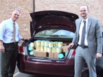TASC Executive Vice President Peter Palanca (left) and Philanthropy Director Ben Underwood (right) with donated formula ready to deliver to families.