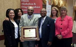 Anthony Harden, recipient of IADDA's 2014 C. Vincent Bakeman Memorial Award, is congratulated by his wife, Gloria, and TASC team members. Left to right: Alisa Montgomery-Webb, Gloria Harden, Anthony Harden, Maxie Knighten, Alicia Kusiak, and Janelle Prueter.