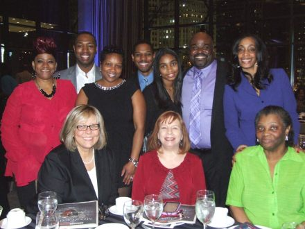 Family members, friends, and colleagues of TASC Clinical Supervisor Khalid Scott gathered to honor him as one of the Chicago Defender's 2015 Men of Excellence.  Front row: Pam Rodriguez, TASC; Jean Mays, TASC; Kathleen Scott, Khalid's mother. Back row, left to right: Rochelle Wade, TASC; Markus McCown, TASC; Marcia Bass, TASC; LaNoah Lomax, mentee; Anayah Scott, Khalid's daughter; Khalid Scott, TASC; Tressa Epps, friend and nominator.