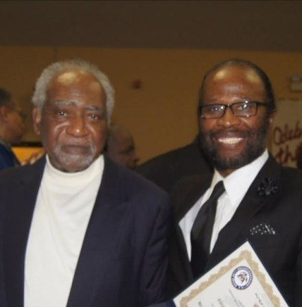 Congressman Danny Davis (left) honors TASC Vice President George Williams for outstanding service to the community.