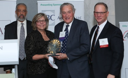 John Kaul Greene (center right) accepts TASC's 2016 Public Voice Leadership Award from (left to right): TASC Board Chair Cecil Curtwright, TASC President Pam Rodriguez, and TASC Executive VP Peter Palanca